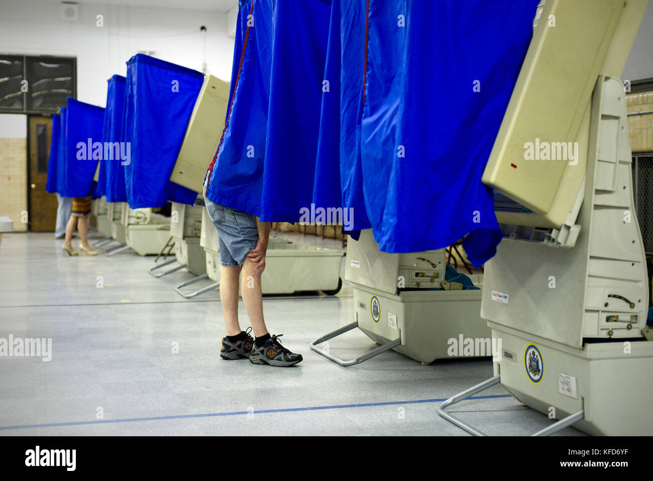 On Election Day, electronic voting machines are lined up at a Philadelphia, PA polling station as citizens cast - Stock Image