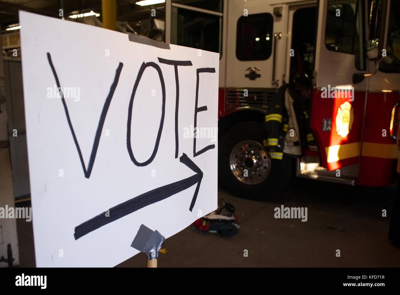 On Election Day a sign directs American citizens to the ballot box of a polling station at a Philadelphia, PA fire - Stock Image