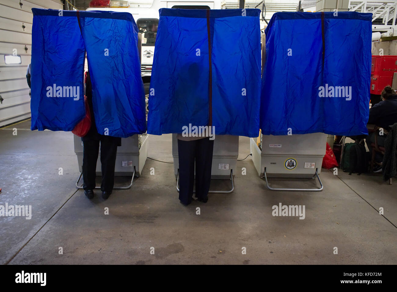 On Election Day, American citizens use electronic voting machines to cast the ballot at a polling station located - Stock Image
