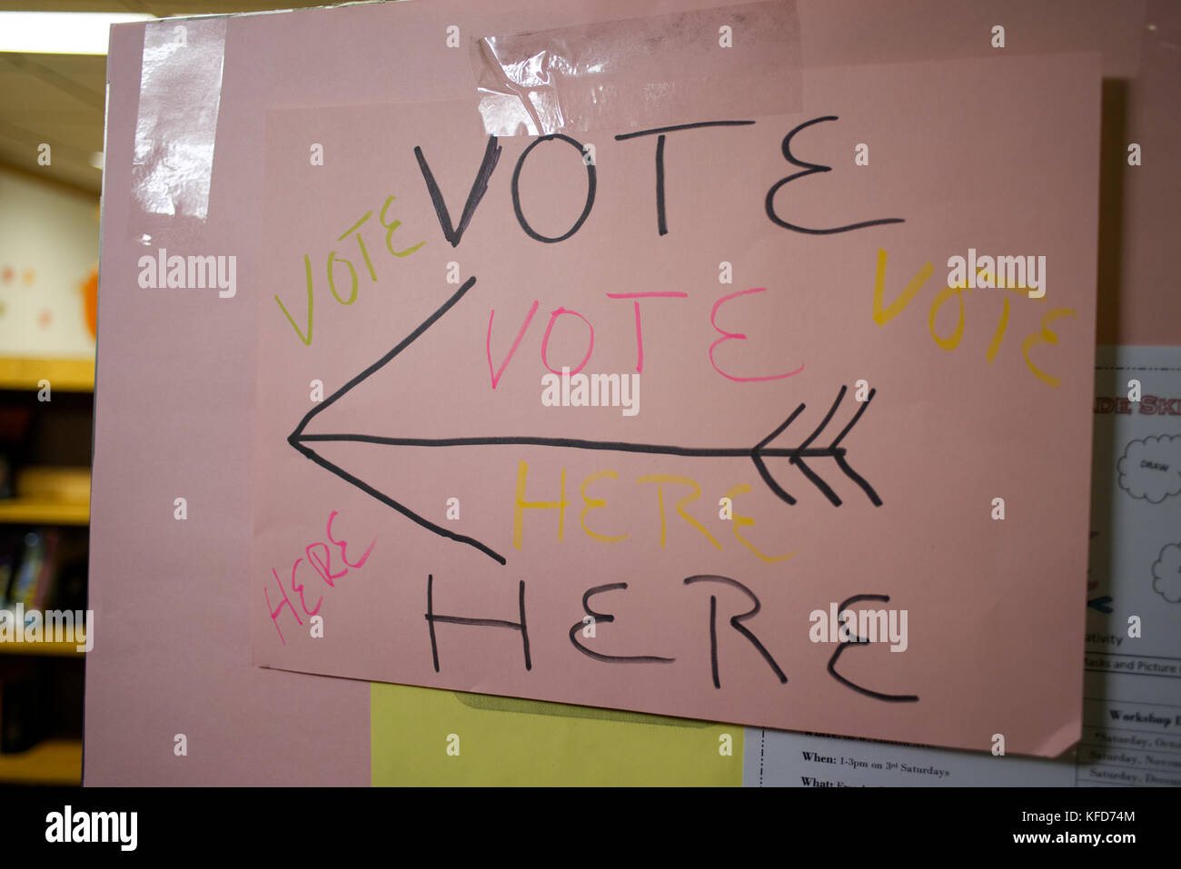 On Election Day, a hand-made sign directs voters to the polling station, located inside a public library, in Philadelphia, - Stock Image