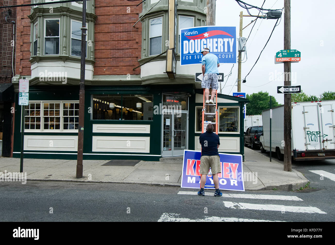 Labor union members mount signs in support of a candidate, outside a popular South Philadelphia, PA diner and meeting - Stock Image