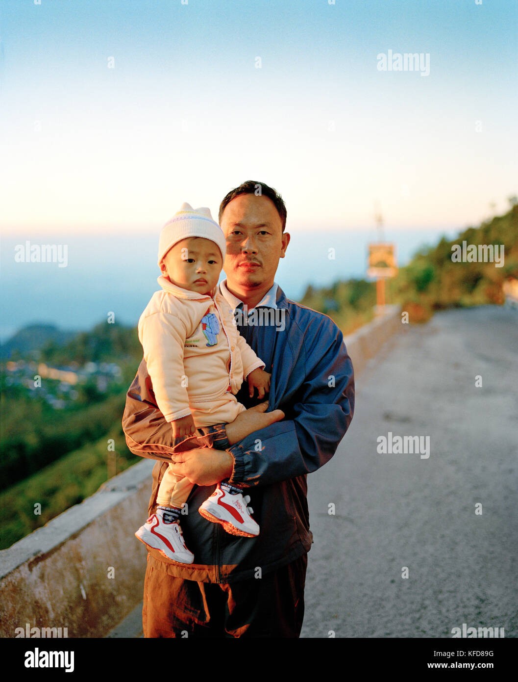 INDIA, West Bengal, portrait of father holding his daughter, Kurseong - Stock Image