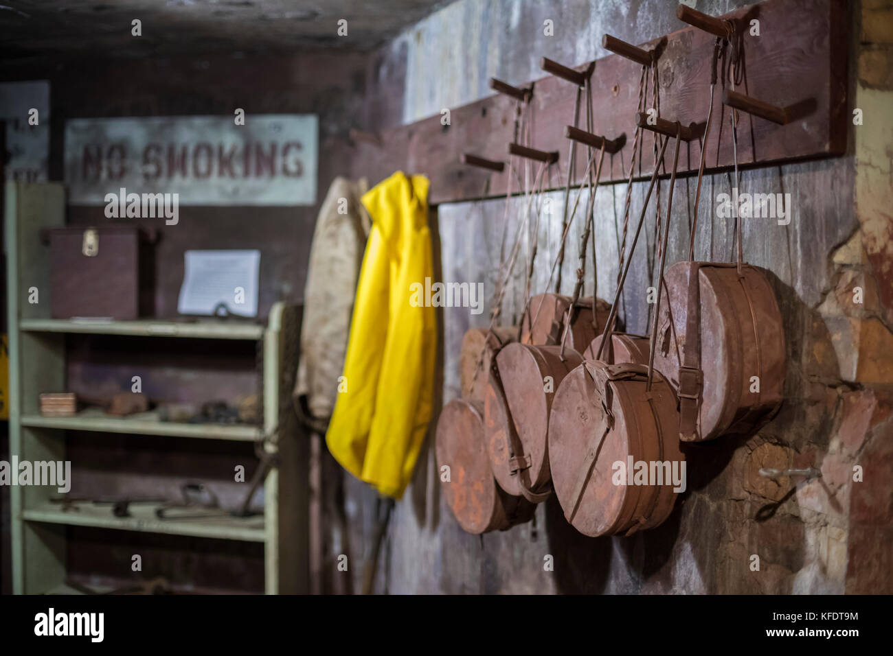 Ishpeming, Michigan - Fuse cans hanging on the wall at the Cliffs Shaft Mining Museum. The museum preserves the - Stock Image