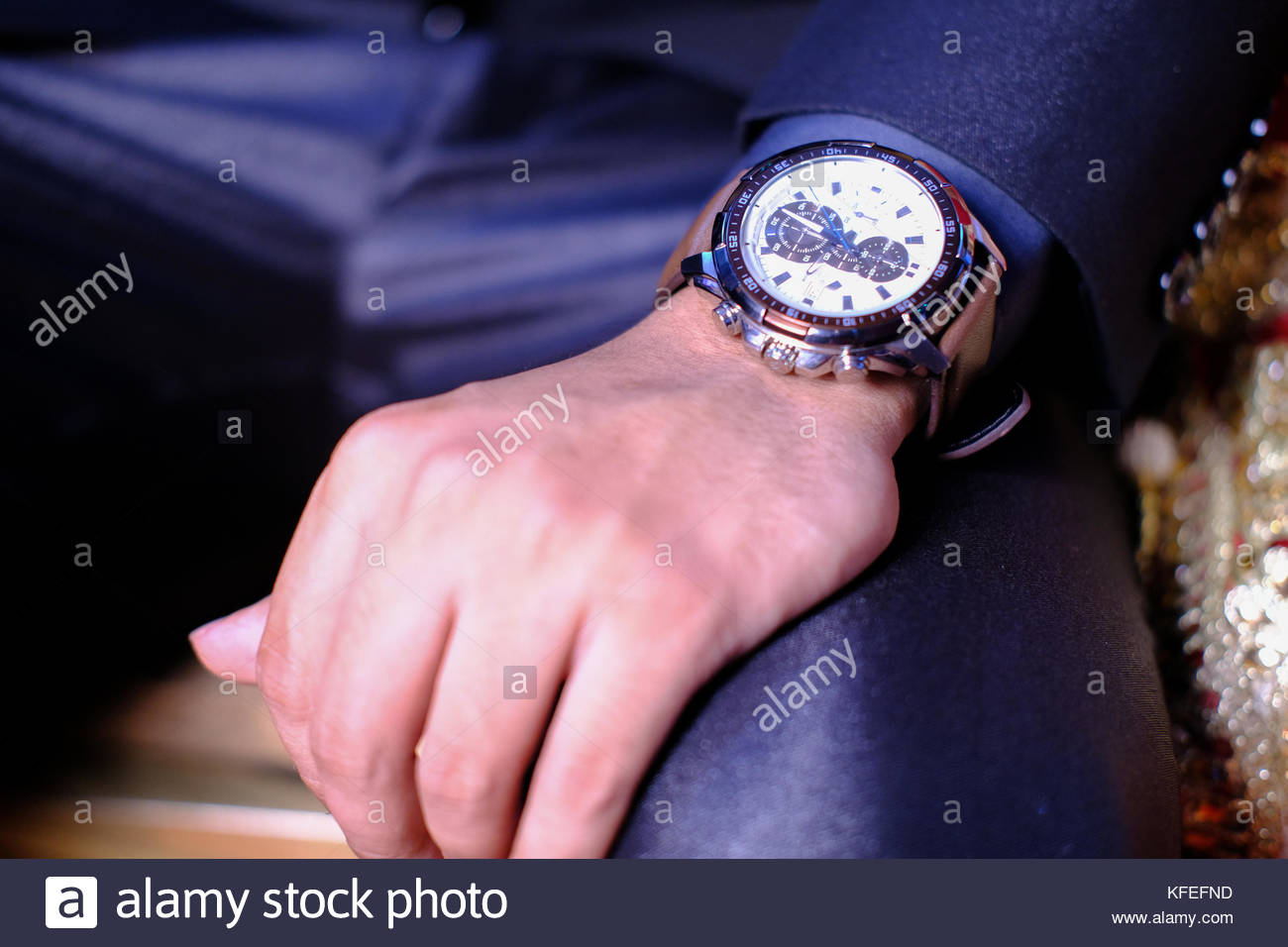 Man with watch thinking. - Stock Image