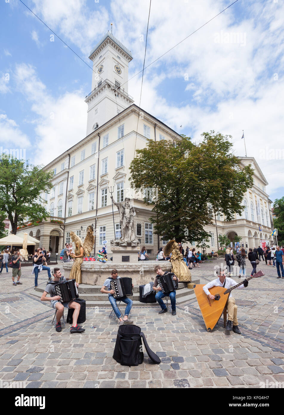 LVIV, UKRAINE - JUNE 3: Street musicians perform Bach on accordions and a balalaika contrabass in Rynok Square, - Stock Image