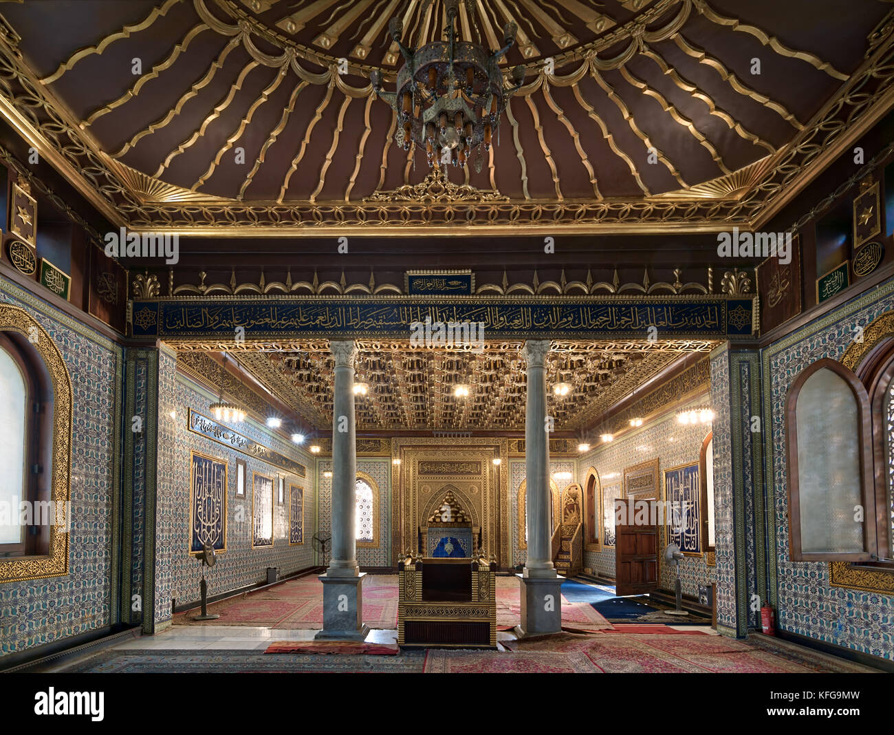 Interior of public mosque of Manial Palace of Prince Mohammed Ali Tewfik with wooden golden ornate ceilings with - Stock Image