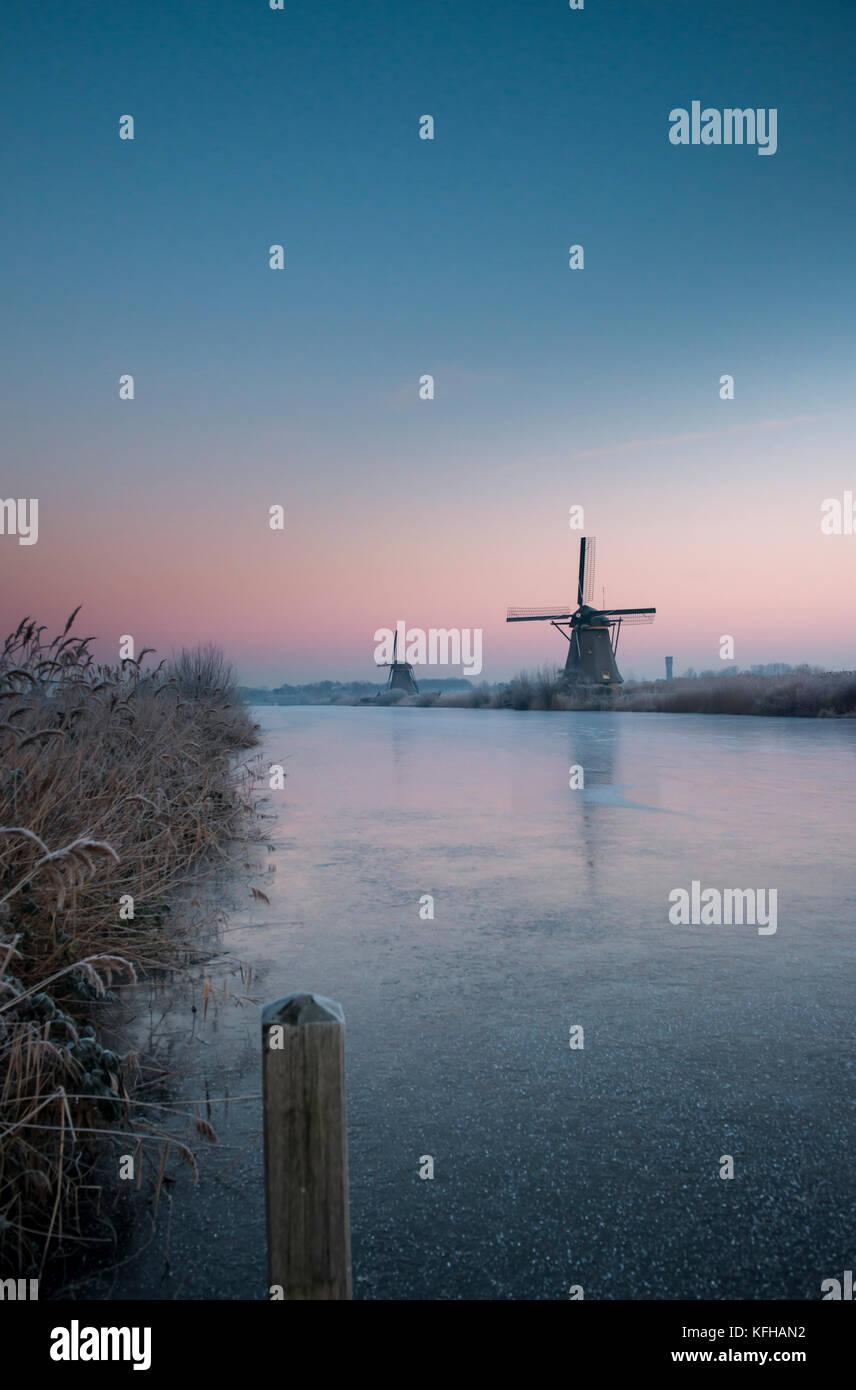 Windmills at the Kinderdijk UNESCO World Heritage Site in the Netherlands - Stock Image
