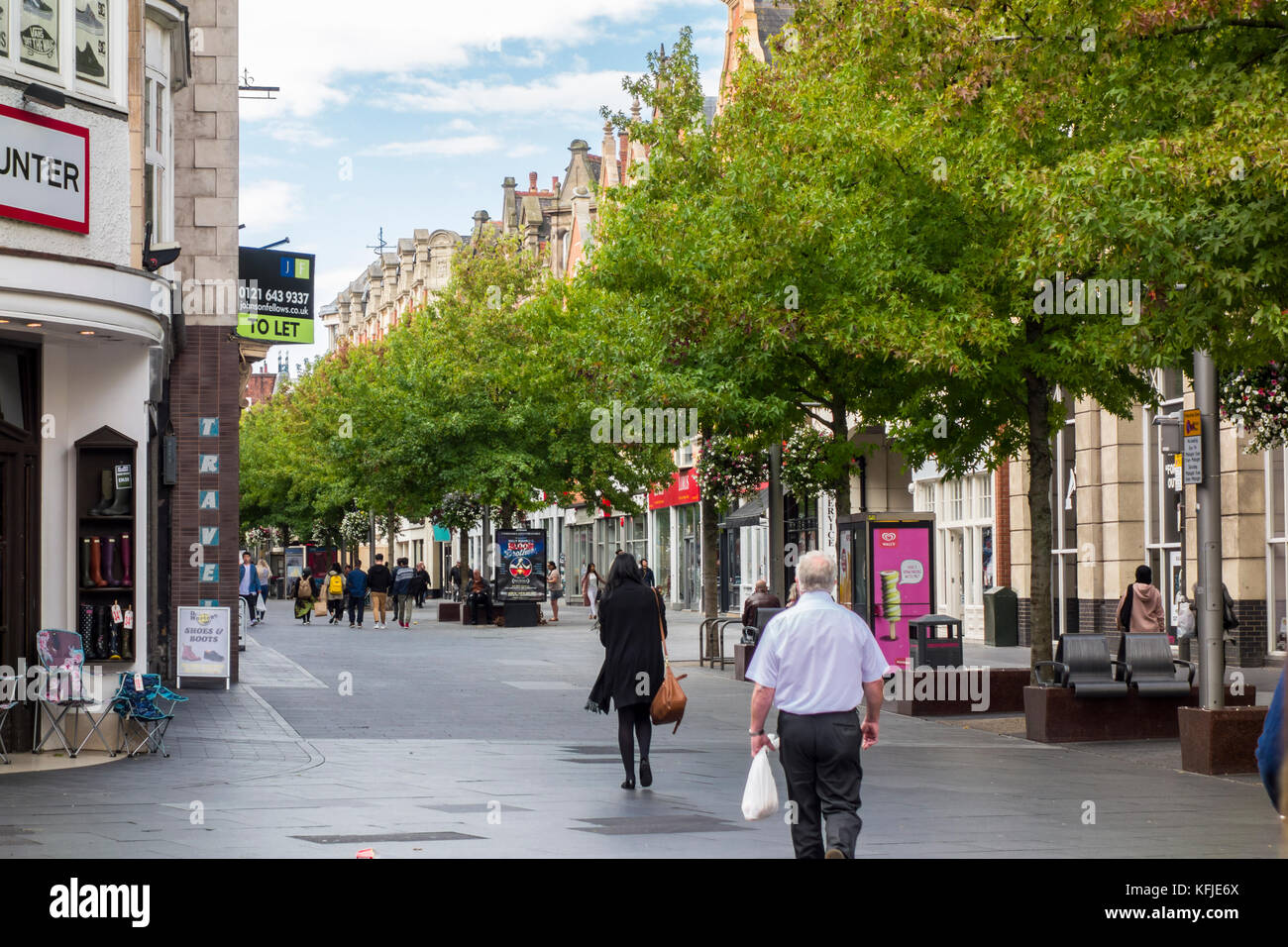 View of trees along High Street, Leicester, Leicestershire, East Midlands, UK - Stock Image