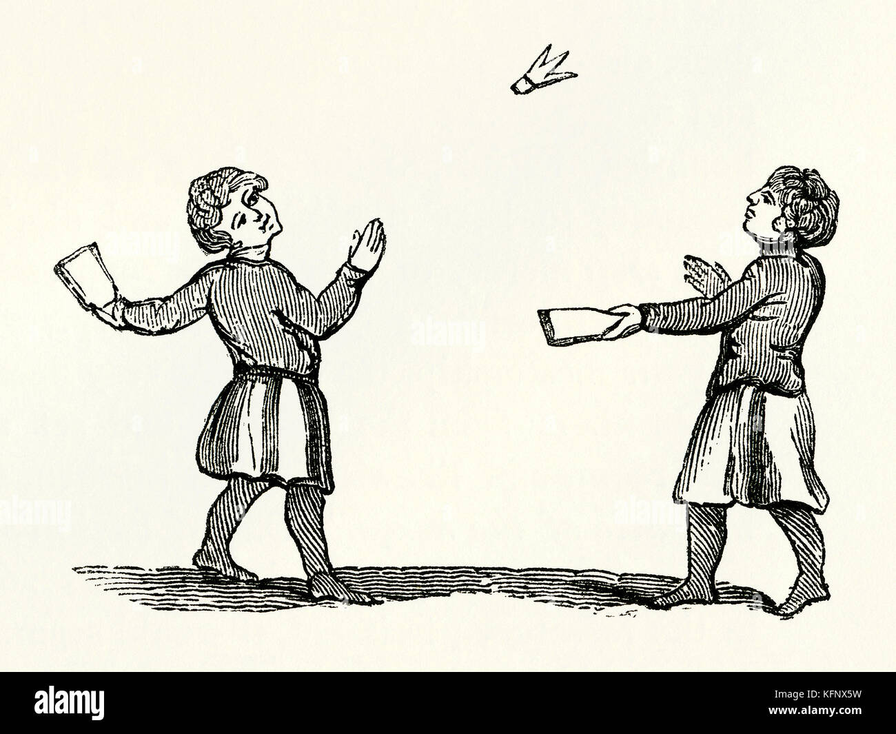 An old Medieval engraving of Battledore and shuttlecock, or jeu de volant, an early game related to modern badminton - Stock Image