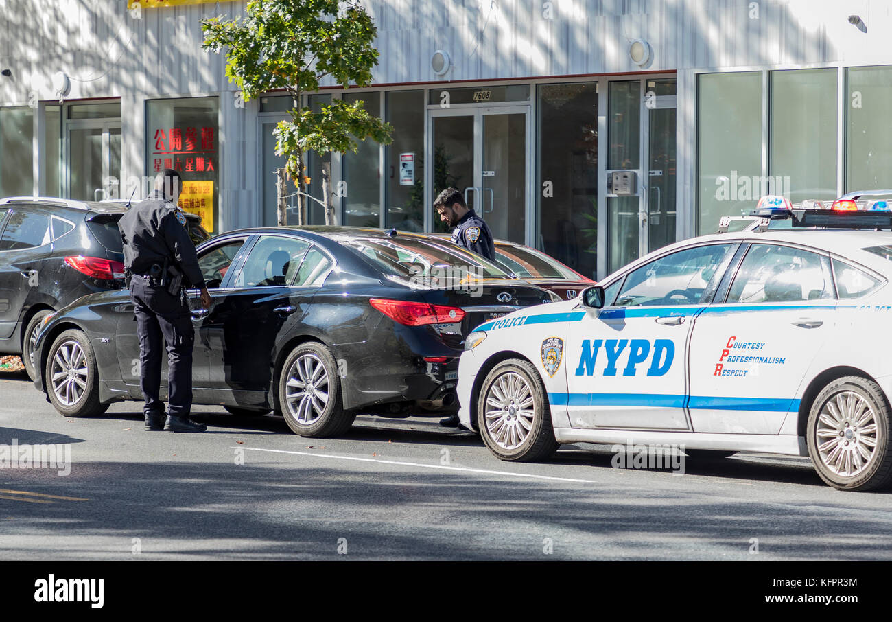 New York, NY, USA - October 31, 2017: Police stops driver for traffic violation on the street of Brooklyn - Stock Image