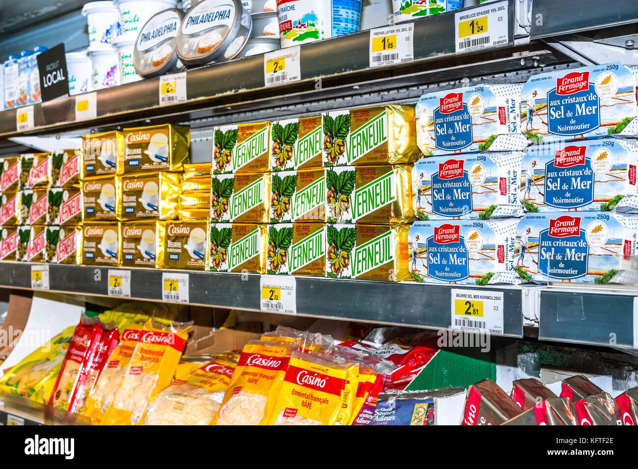 Packs of butter on shop shelf - France. - Stock Image