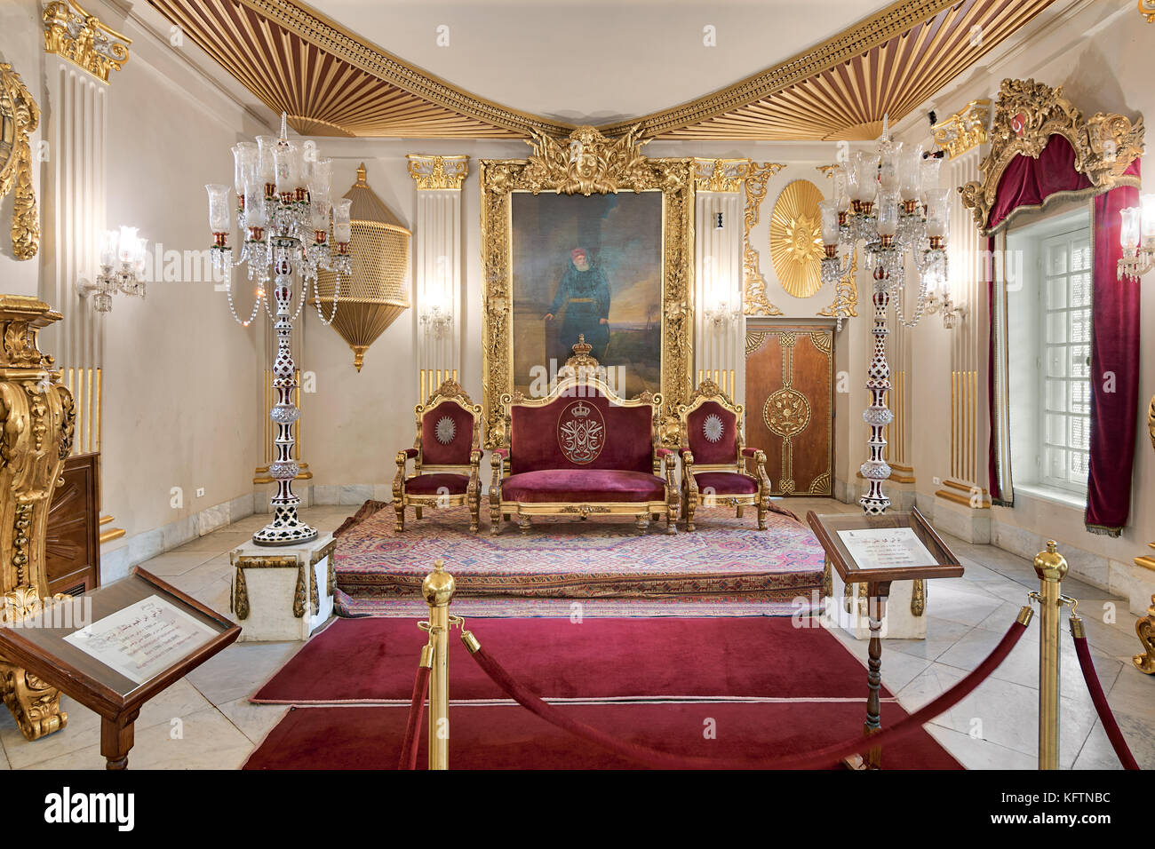 Cairo, Egypt - October 21, 2017: Throne Hall at Manial Palace of Prince Mohammed Ali Tewfik with gold plated red - Stock Image