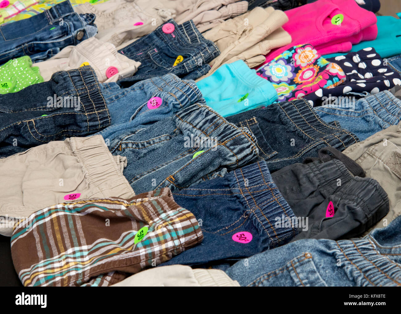 Children`s pants on display at a suburban garage sale - Stock Image