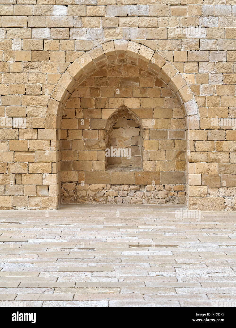 Stone wall with embedded niche, Exterior wall at the corridors surrounding Alexandria castle - Stock Image