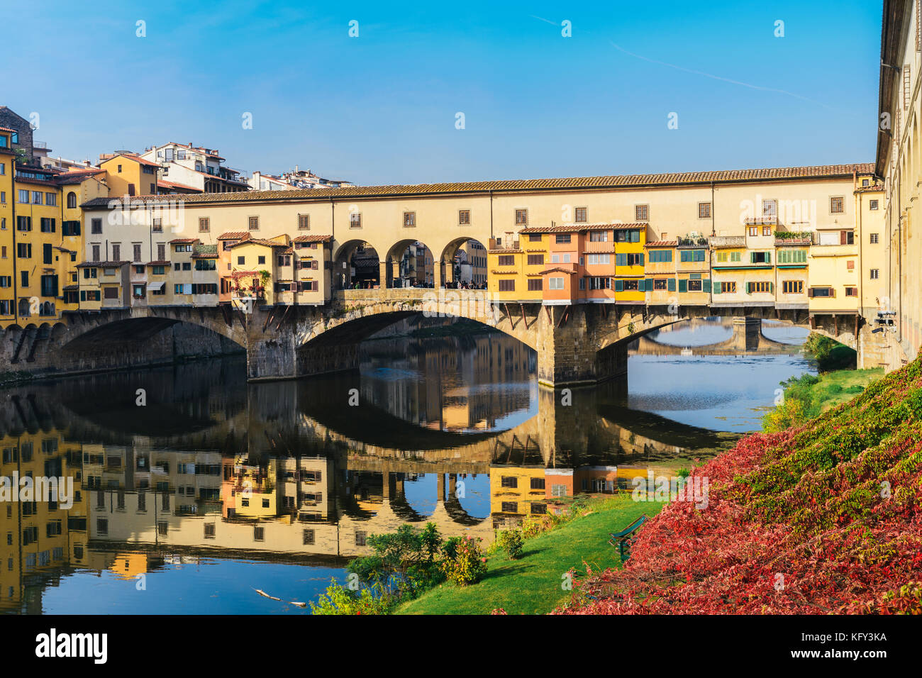 Ponte Vecchio (old bridge) in Florence, Tuscany, Italy on a beautiful autumn day Stock Photo
