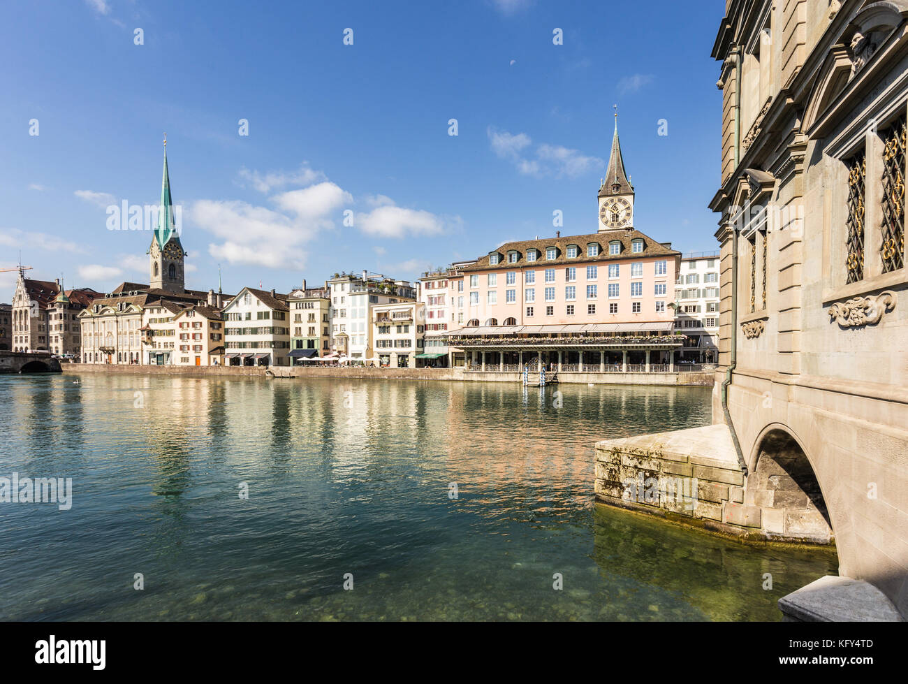 The facades of traditional building reflecting in the Limmat river in Zurich old town in Switzerland on a sunny - Stock Image