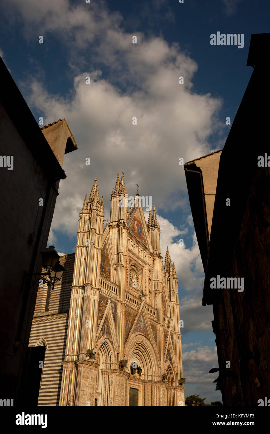 The Duomo is lit by the setting sun in Orvieto, Italy. - Stock Image