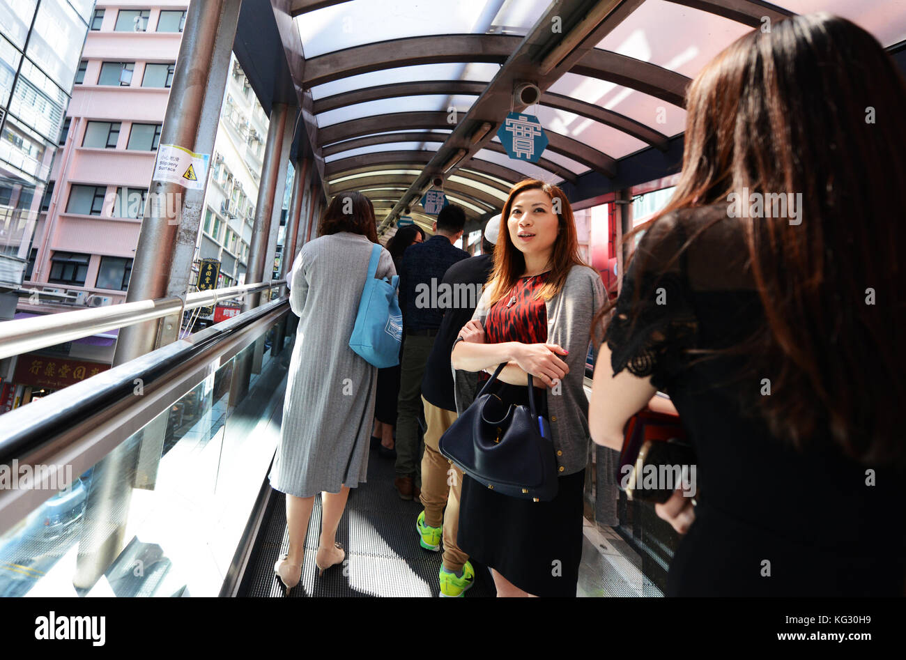 The Central–Mid-Levels escalator and walkway system in Hong Kong is the longest outdoor covered escalator system - Stock Image