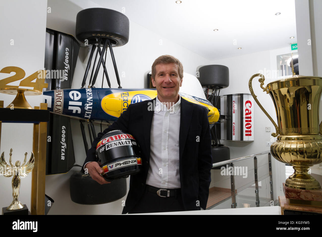 Ex Formule 1 coureur Thierry Boutsen standing next to the Formula 1 car which contributed to his first victory with - Stock Image