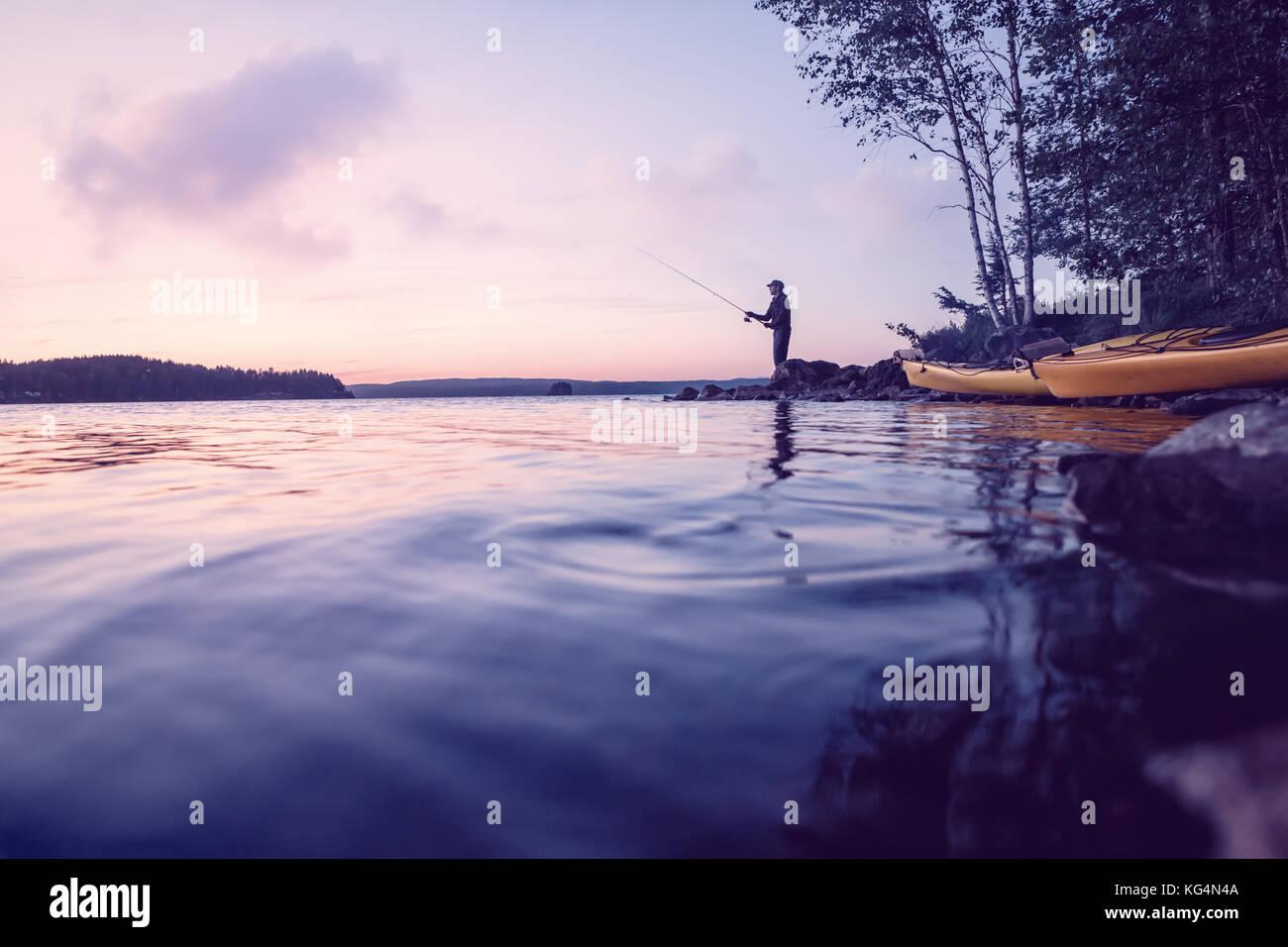 Fishing at a beautiful lake - Stock Image