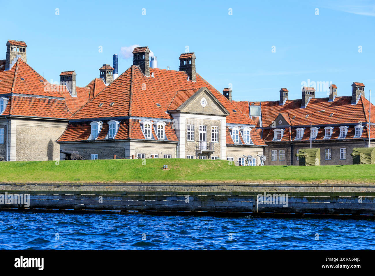 Typical houses of residential area seen from a boat trip along the canals of Copenhagen, Denmark - Stock Image