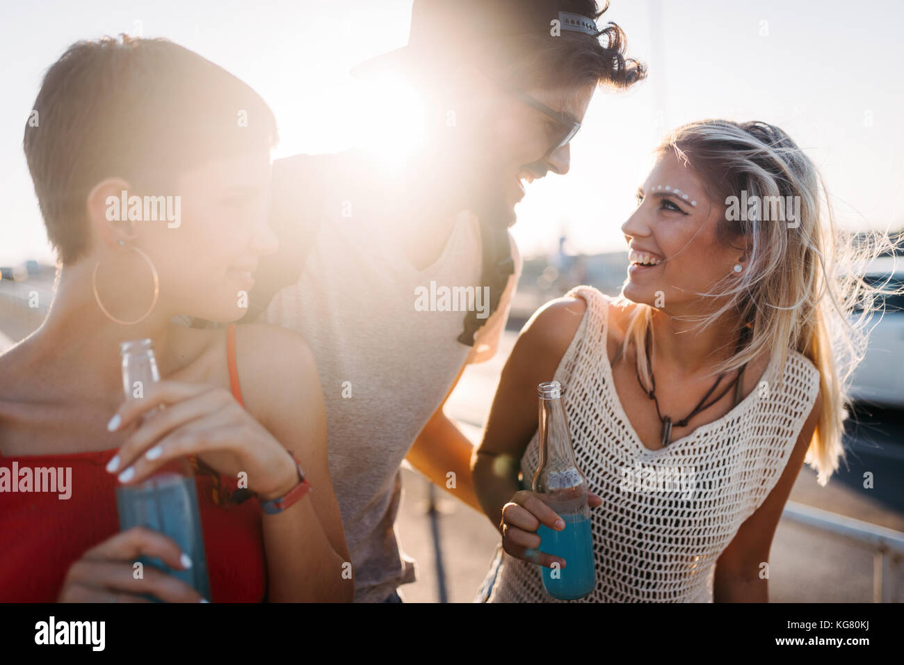 Group of young happy friends having fun time - Stock Image