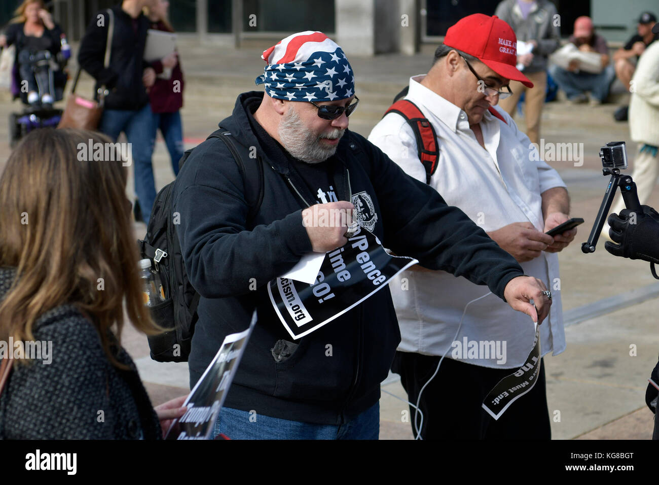 Philadelphia, United States. 04th Nov, 2017. After getting counter-protestors tear anti-Trump/Pence flyers in an - Stock Image