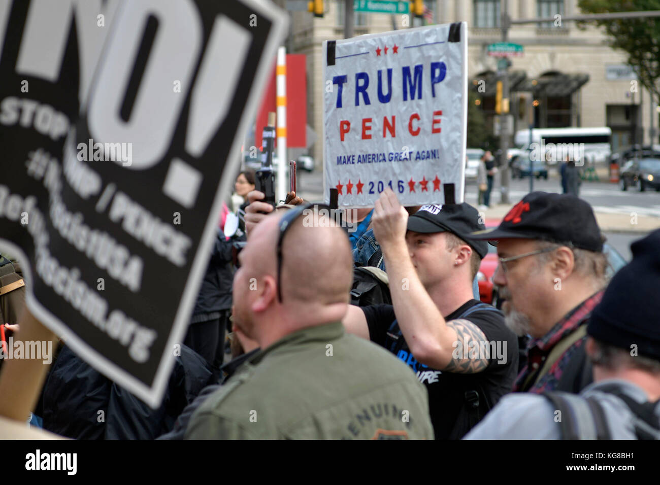 Philadelphia, United States. 04th Nov, 2017. In an attempt to provoke an altercation Trump supporters hold up signs - Stock Image