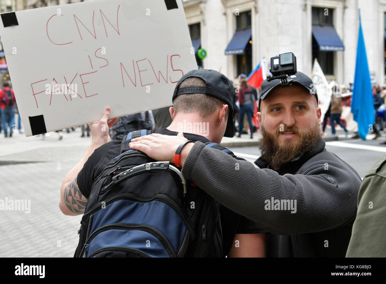 Philadelphia, United States. 04th Nov, 2017. In an attempt to provoke an altercation Trump supporters follow in - Stock Image