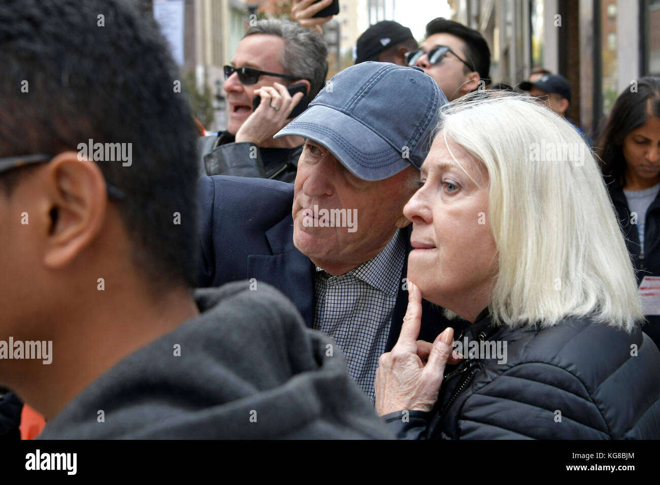 Philadelphia, United States. 04th Nov, 2017. Bystanders look on as protestors take the Center City streets during - Stock Image