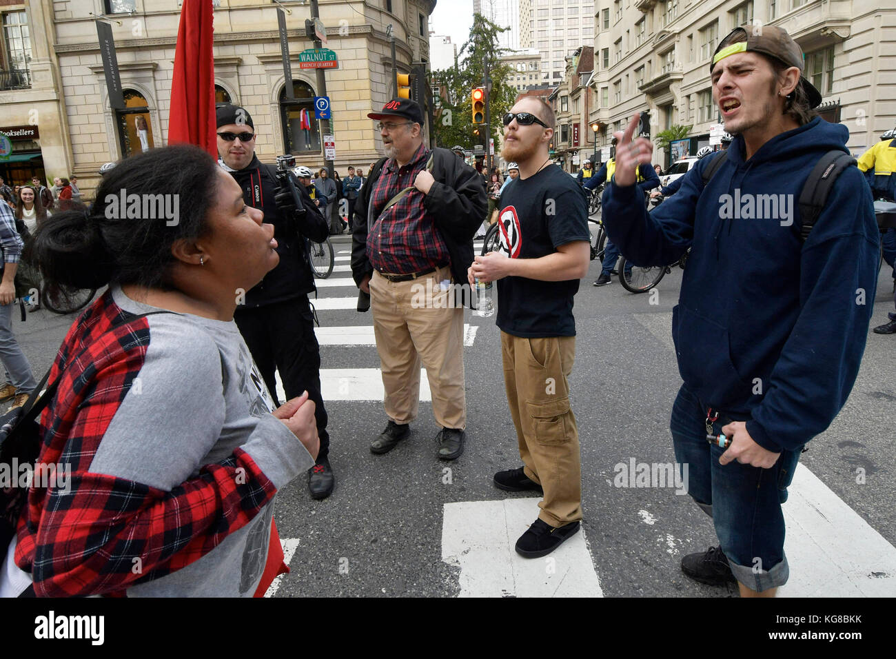 Philadelphia, United States. 04th Nov, 2017. Protestors participating in a Refuse Fascism rally engage in discussion - Stock Image