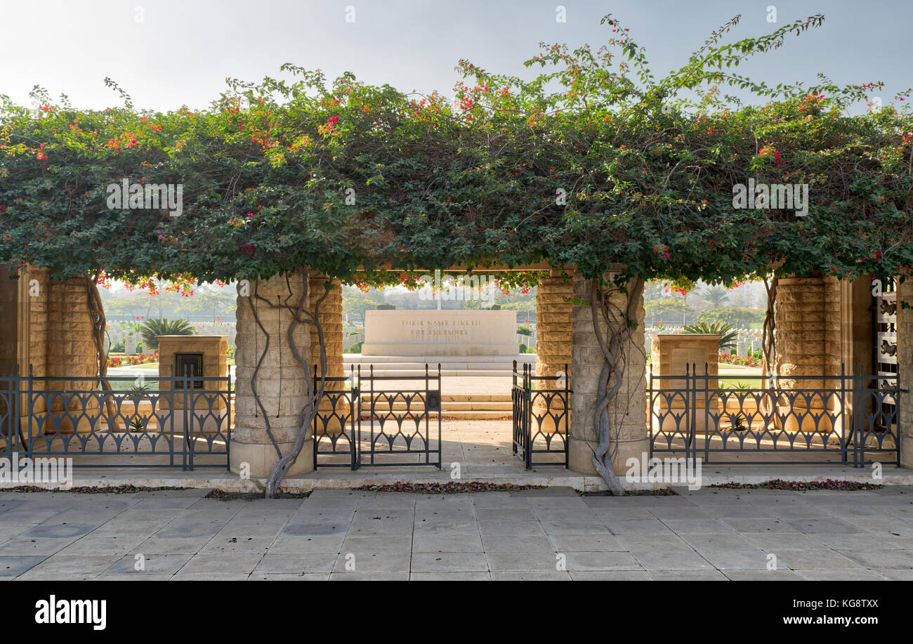 Cairo, Egypt - December 7, 2016: Entrance of Heliopolis Commonwealth War Cemetery with fence metal door, climber - Stock Image