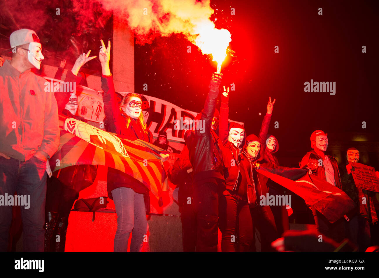 London, United Kingdom. 05th Nov, 2017. Million Mask March 2017 takes place in central London. A protester holds - Stock Image