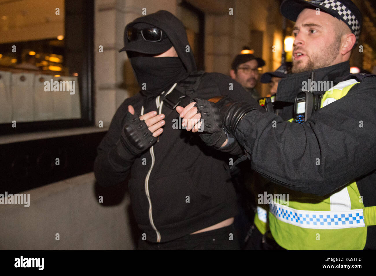 London, United Kingdom. 05th Nov, 2017. Million Mask March 2017 takes place in central London. A protester is arrested. - Stock Image