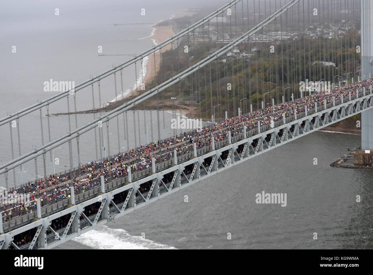 Runners cross the Verrazano-Narrows Bridge at the start of the annual New York City Marathon November 5, 2017 in - Stock Image
