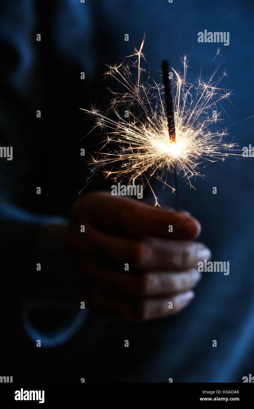 Hand held sparkler - Stock Image