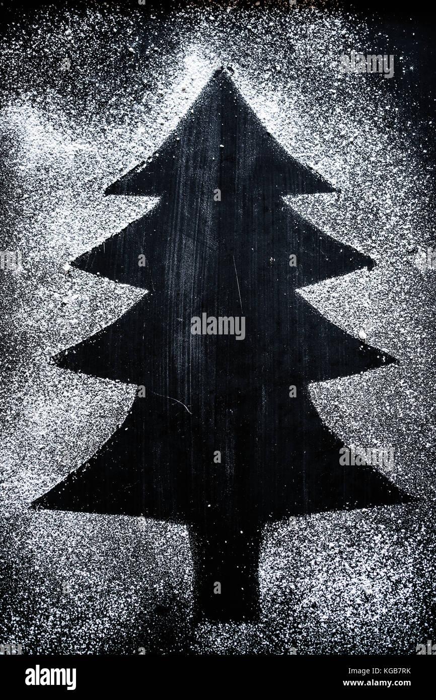 a fake christmas tree, drawn with icing sugar - Stock Image