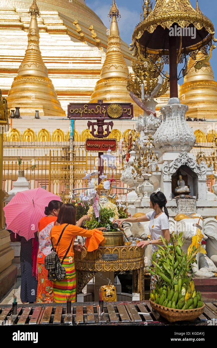 Burmese visitors at the Monday planetary post at the Shwedagon Pagoda / Golden Pagoda in Yangon, Myanmar in Yangon - Stock Image