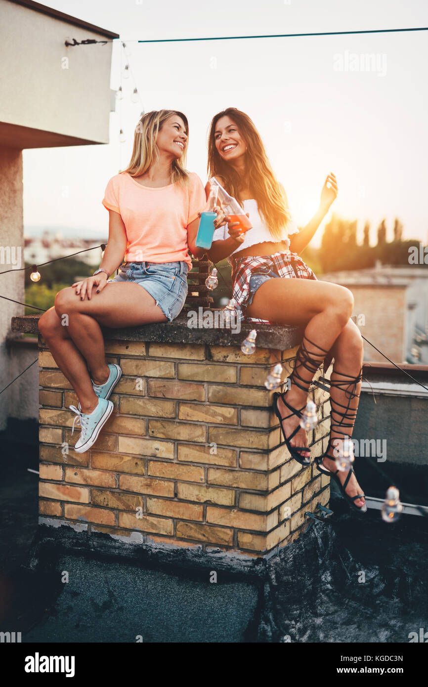 Happy young girls having fun at party - Stock Image