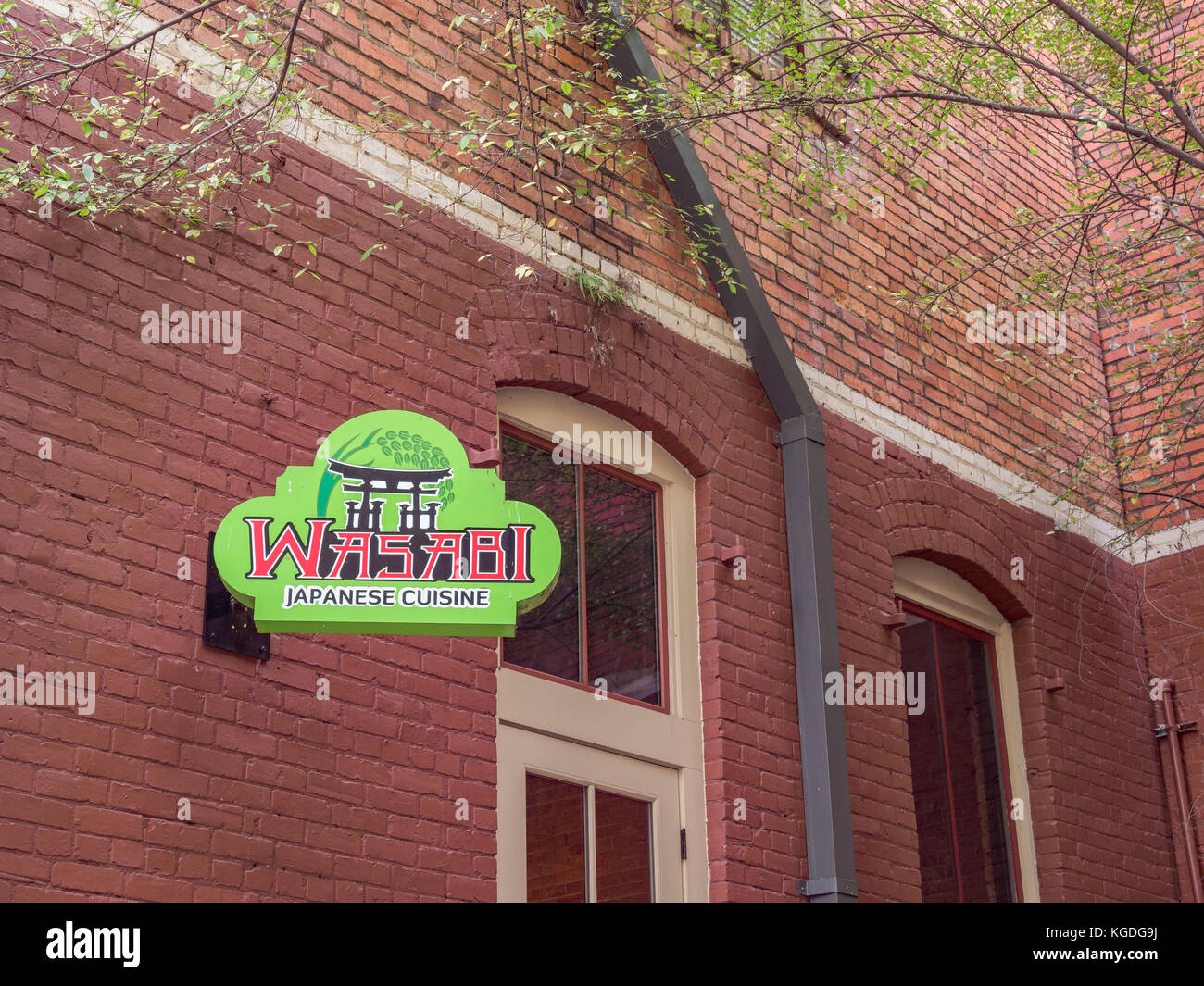 Green sign for Wasabi Japanese Cuisine restaurant in the popular urban space called The Alley, in Montgomery, Alabama - Stock Image