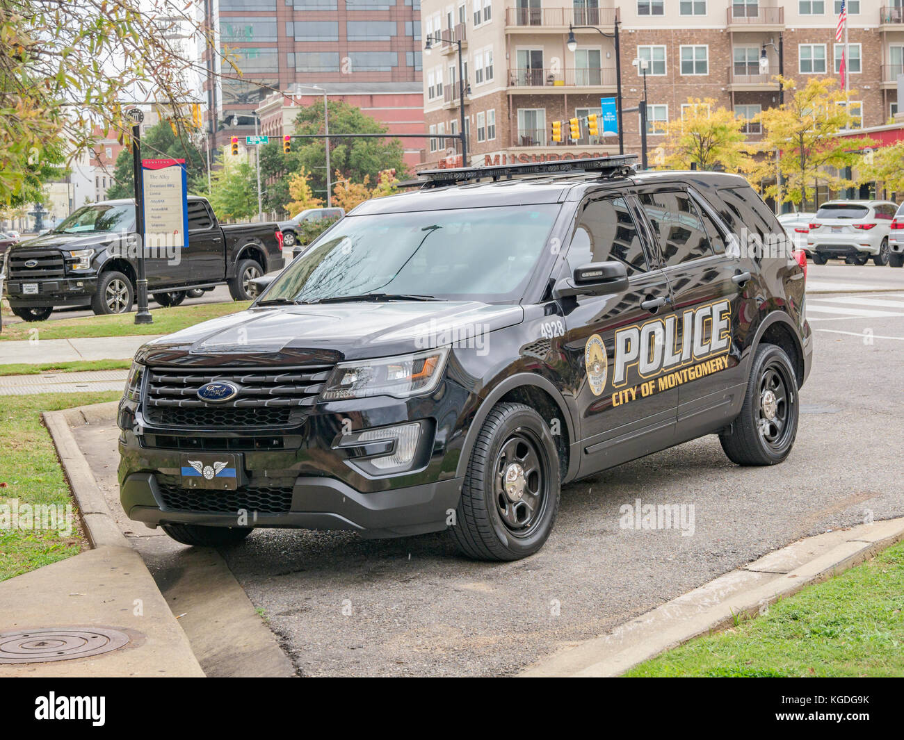 Black police SUV, Ford Explorer police interceptor, parked in downtown Montgomery, Alabama USA. - Stock Image