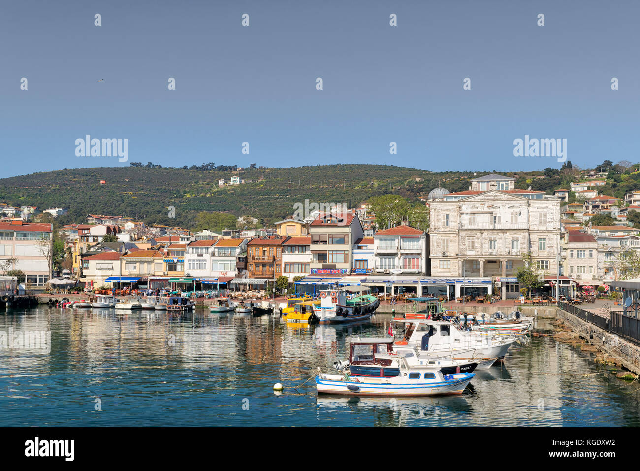 Istanbul, Turkey - April 27, 2017: View of Burgazada island from the sea with summer houses and a small mosque. - Stock Image