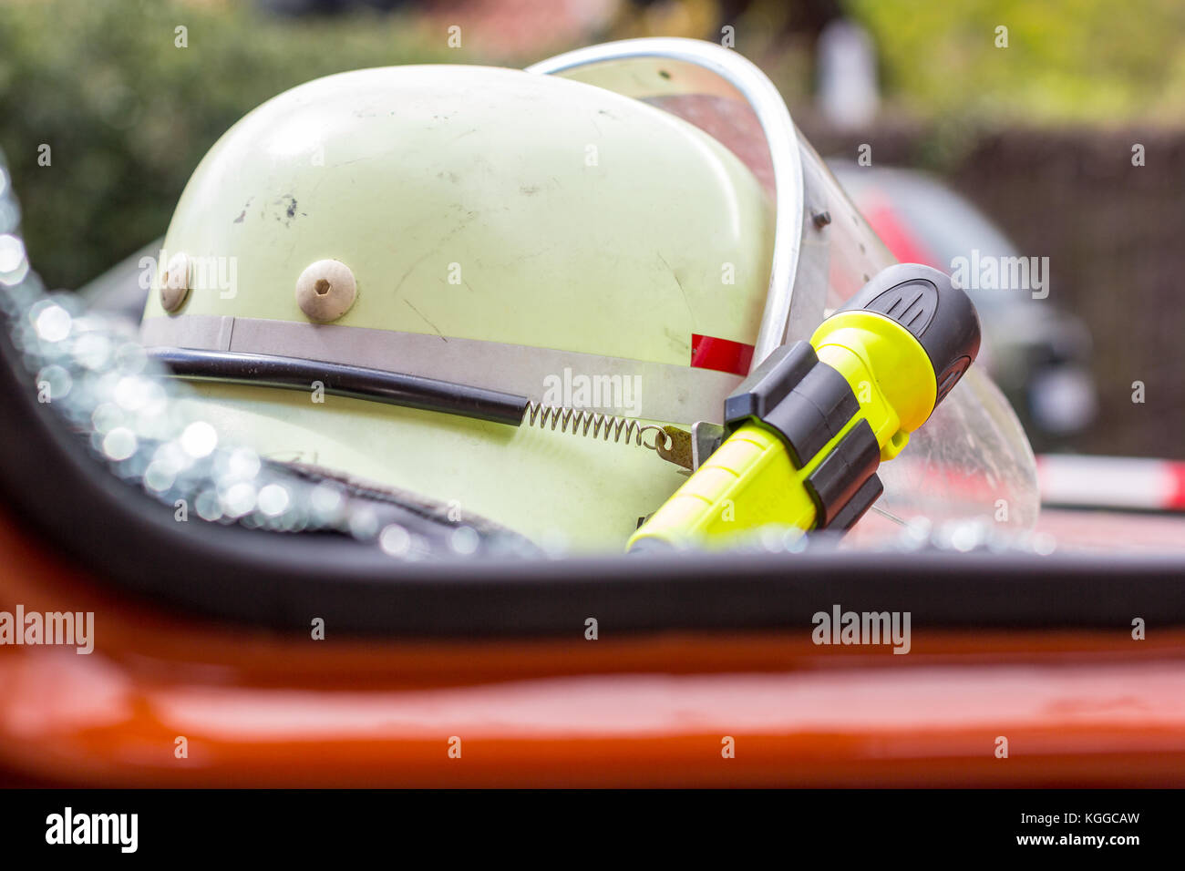 german fireman helmet with a yellow lamp - Stock Image
