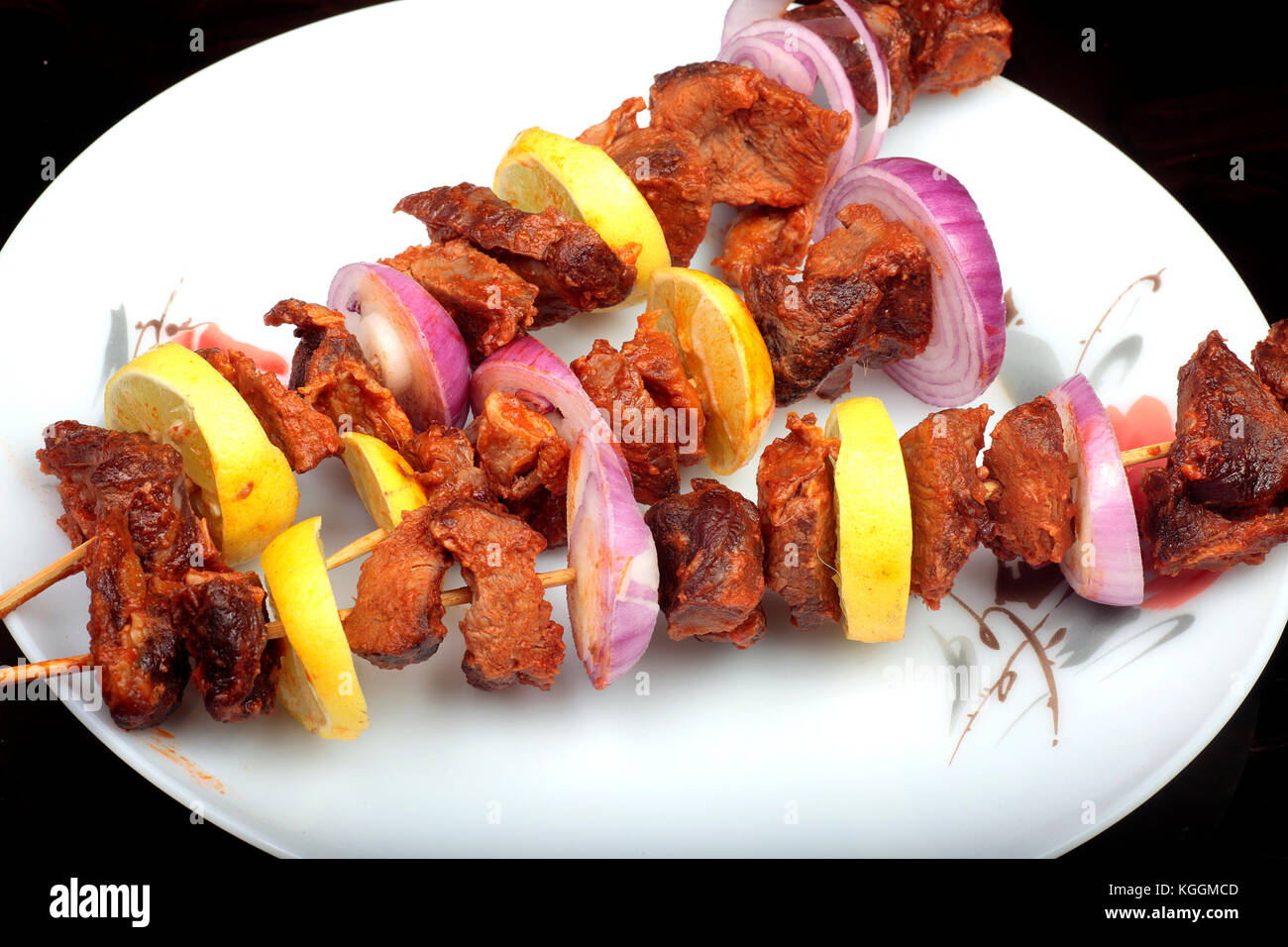fresh-roasted-lamb-mutton-kebabs-on-skewers-KGGMCD.jpg
