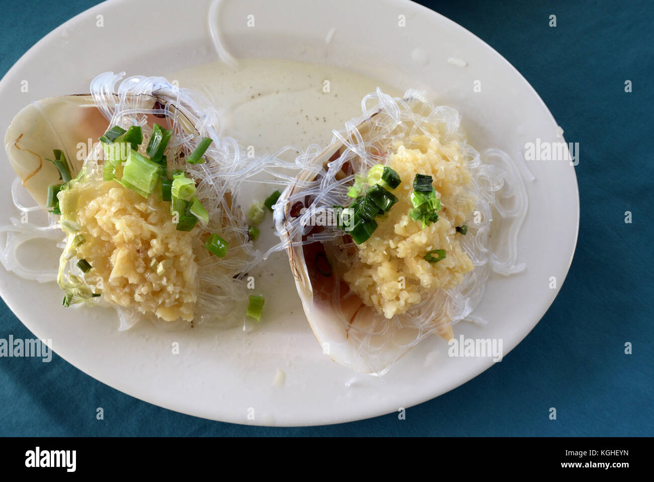 Clam with Garlic served in a seafood restaurant on Lamma island. - Stock Image
