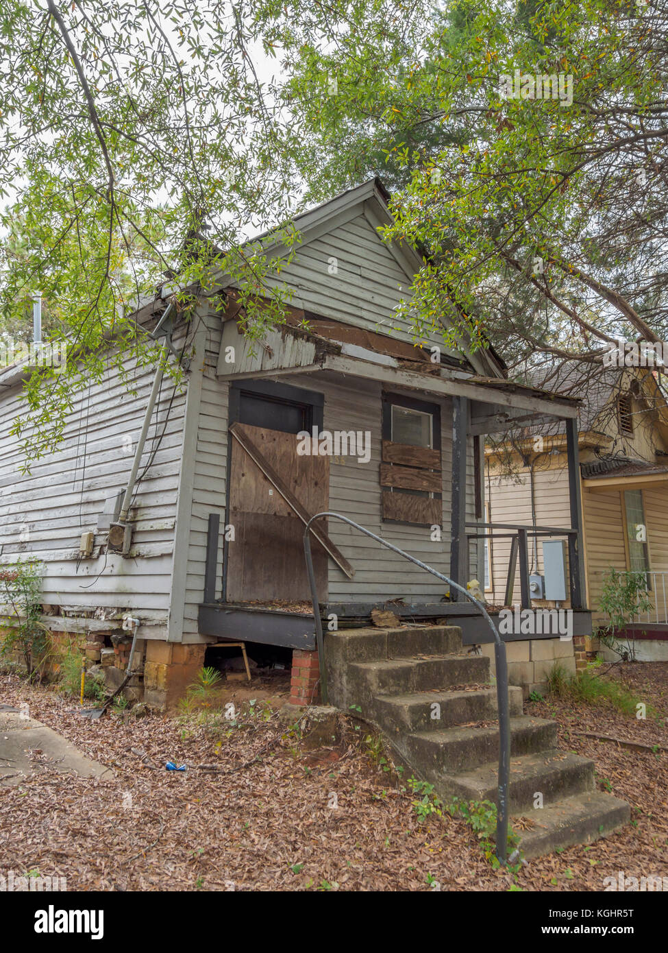 Boarded up, abandoned, house in urban decline, decay, blight, and American poverty in Montgomery, Alabama USA. - Stock Image
