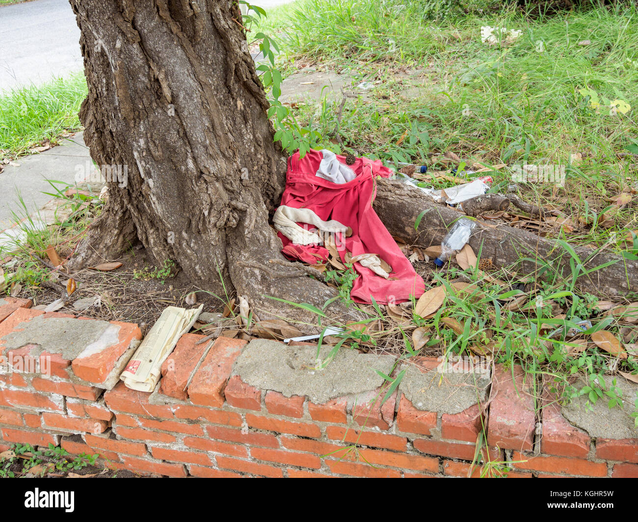 Trash and garbage on a street corner causing urban blight in a poverty stricken residential neighborhood in Montgomery - Stock Image