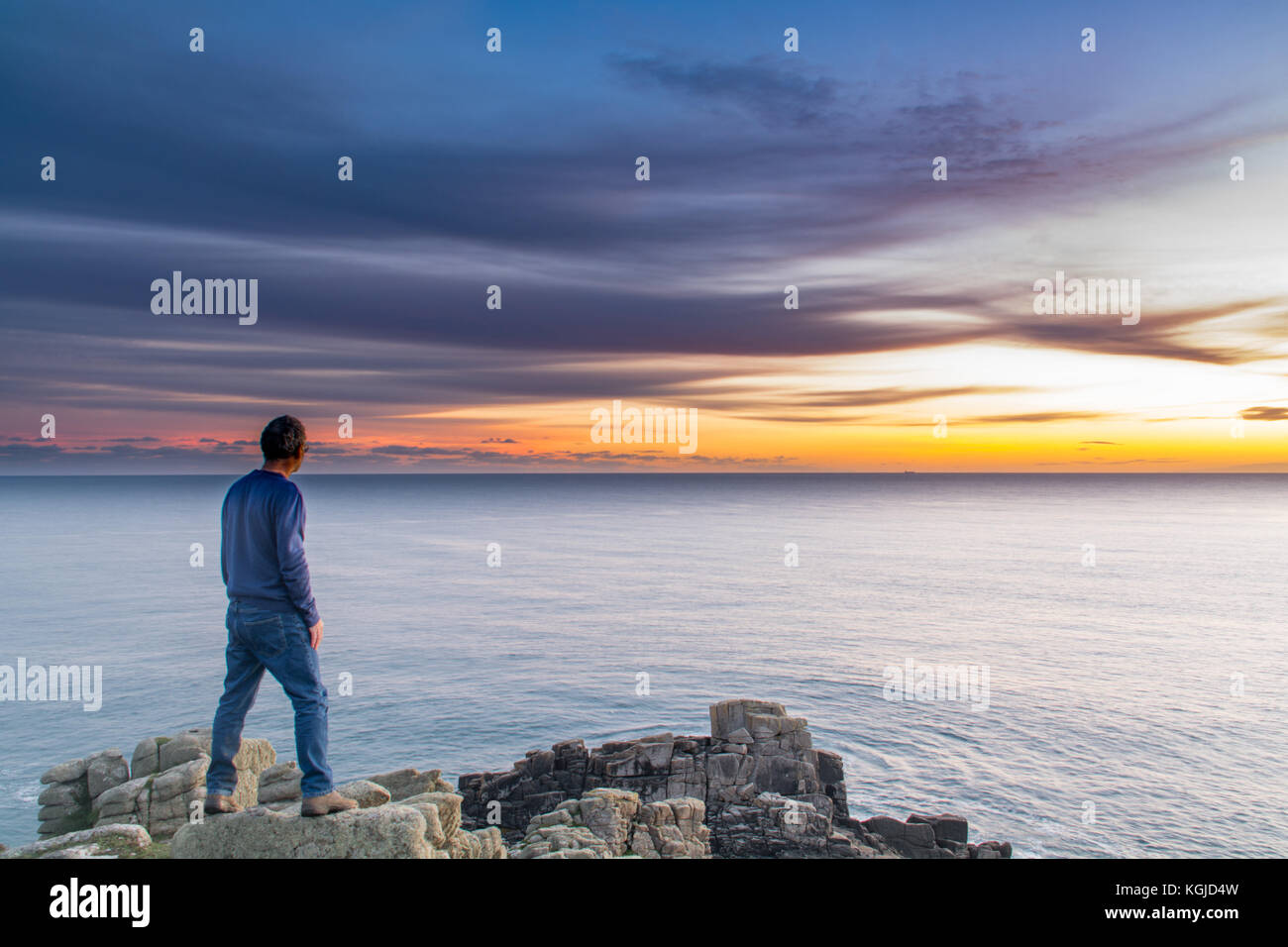 Lamorna, Cornwall, UK. 8th November 2017. UK Weather. Calm seas over the far south west of Cornwall at sunset. Credit: - Stock Image