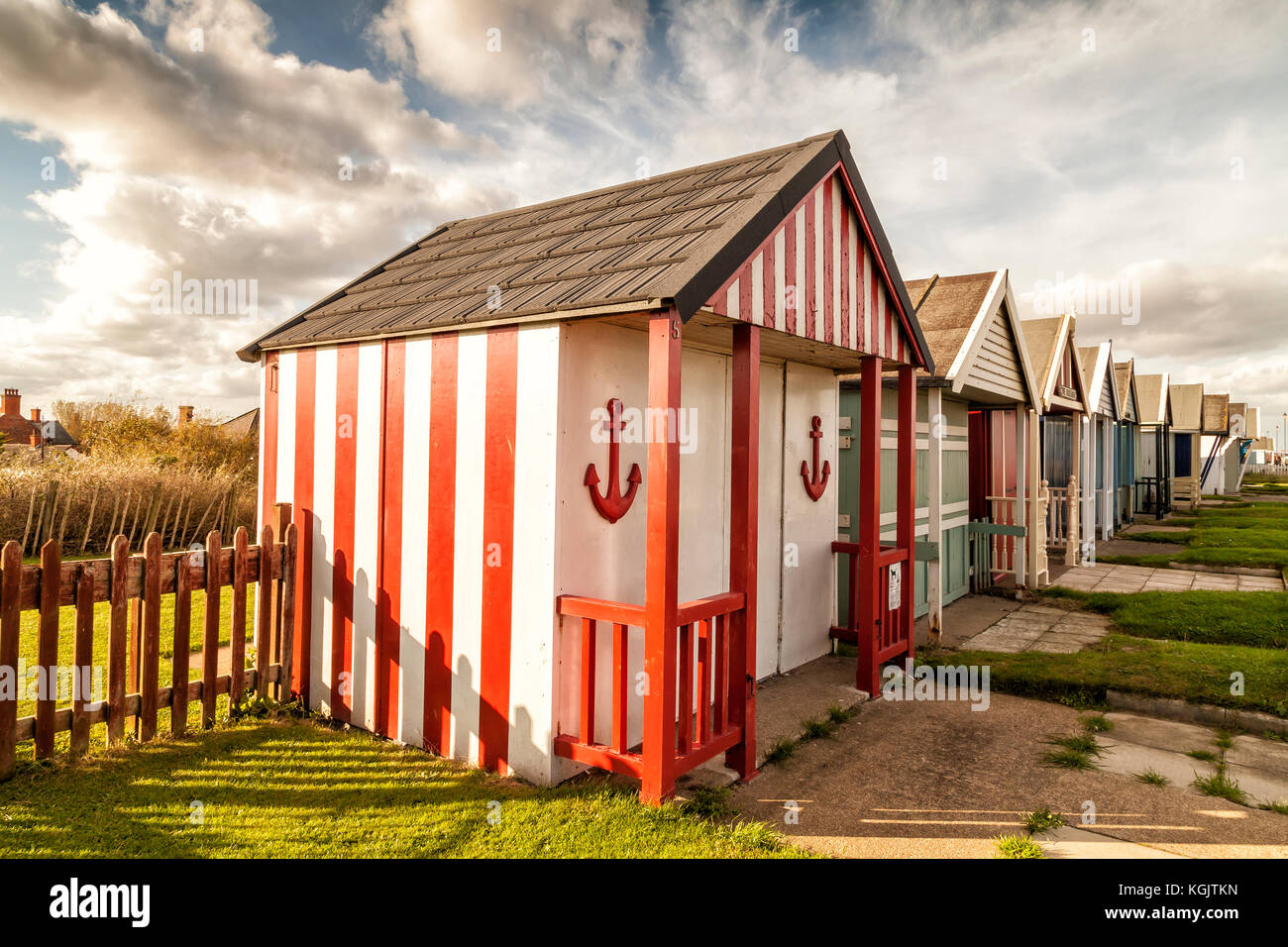 Beach Huts on promenade at Sutton on Sea, east Coast of England October 2017 - Stock Image