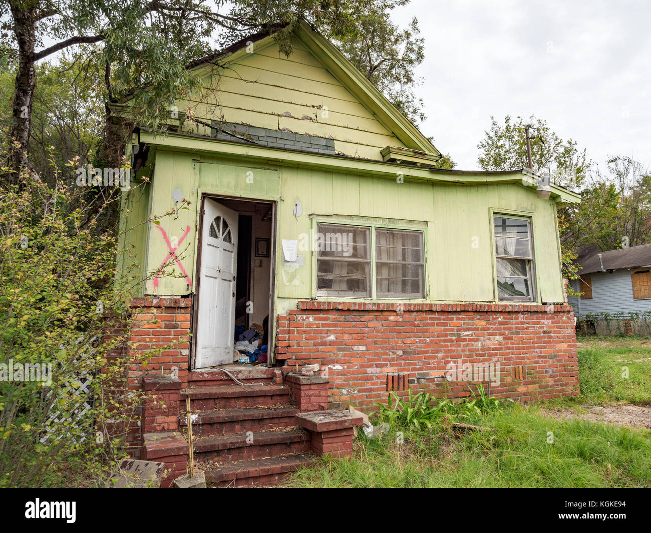 Boarded up, abandoned, house showing urban decline, decay, blight, and American poverty in Montgomery, Alabama USA. - Stock Image